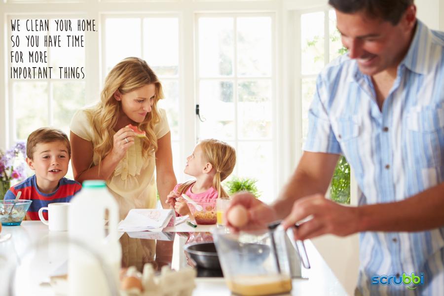 Family enjoying breakfast in clean house