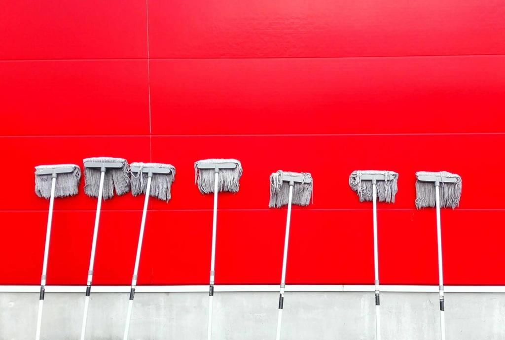 red wall with mops