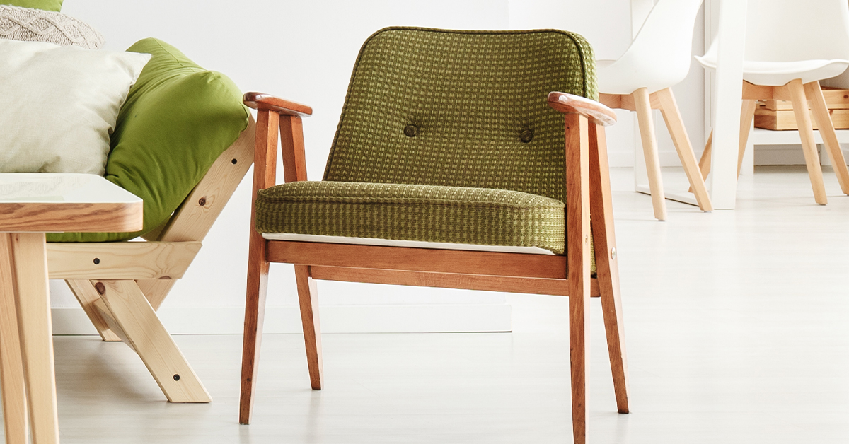 mid-century wooden chair with green upholstery